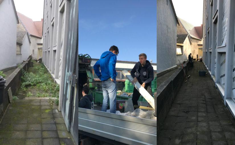 Saubermachaktion der Messdiener hinter St. Gertrud